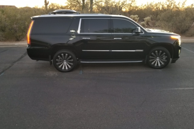 Black 2016 Escalade with Satellite TV at dusk. Part of the Phoenix Limo Service fleet.
