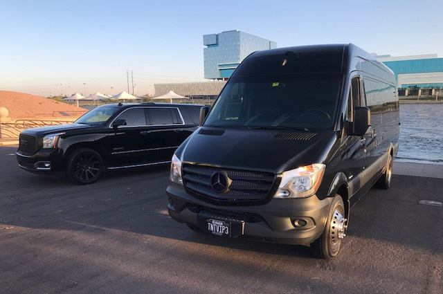 Black Sprinter and black Denali parked side by side on Tempe Town Lake. Part of our Phoenix Limo Service fleet.