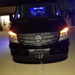 Nighttime Phoenix Sprinter executive transportation and party bus